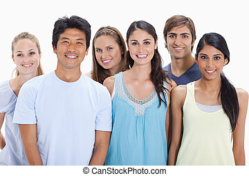 Close-up of people smiling together against white background