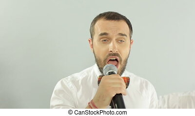 Close-up of performance of singer as part of of the musical group in the studio on a white background