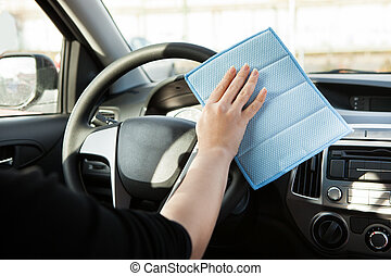 Person Cleaning Steering Wheel In Car