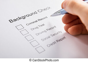Person Hand Filling Background Check Form