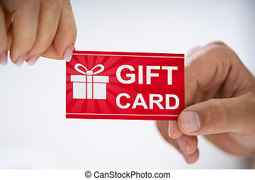 Close-up Of Person Hand Giving Gift Card