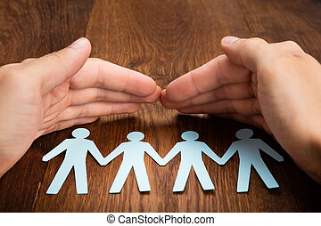 Person Hand Protecting Human Figure Cutout