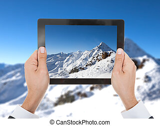 Person Hand Taking Photo Of Snowy Mountain