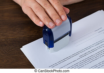 Person Hands Stamping Document