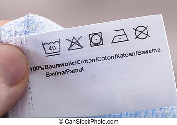 Person Reading Clothing Label