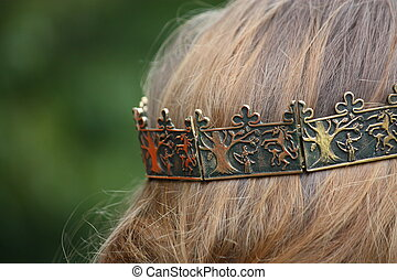 Close up of person with medieval crown on head