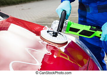 Person's Hand Polishing Car Hood