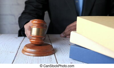 close up of person's hand striking the gavel