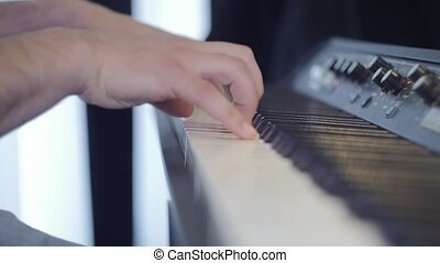 Close-up of Pianist Man's hands playing with fascinating the Piano