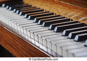 Close up of piano keyboard with limited depth of field