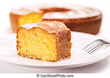 close up of piece of cake with icing sugar