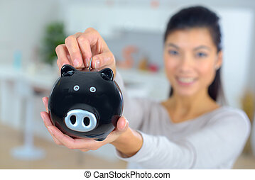 close-up of piggy bank in female hands