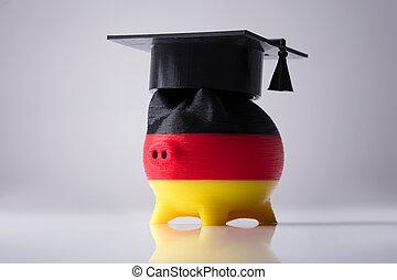 Piggybank Painted With German Flag Wearing Graduation Hardhat