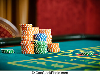 Close up of piles of chips on the roulette table