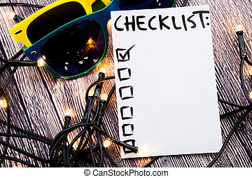 Close up of pin and to do list Checklist word on sticky note with wooden background