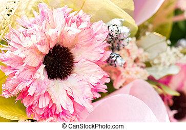 Close up of pink artificial flower bouquet.
