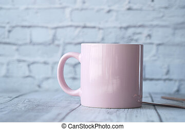 Close up of pink color coffee cup on table