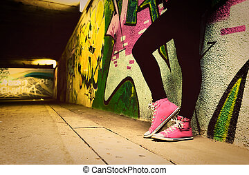 Close up of pink sneakers worn by a teenager.