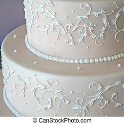 wedding cake - close up of pink wedding cake with white...