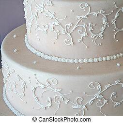 wedding cake - close up of pink wedding cake with white...