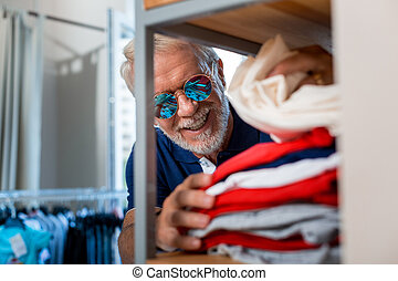 Close up of pleased elderly fashionable man at shopping store