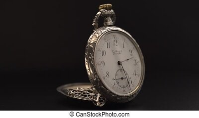 Close up of pocket watch rotate - Close up of silver pocket...