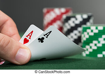 Poker Player Lifting Two Cards