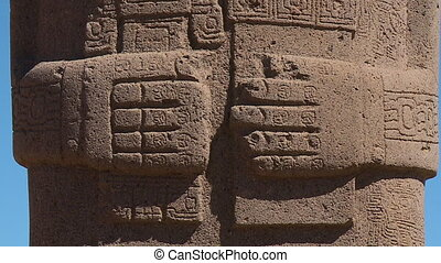 Extreme close-up low angle tilting shot of Ponce Monolithic statue's hand and body stone carvings, La Paz, Bolivia