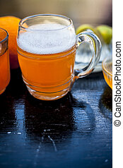 Close up of popular summer drink i.e. Ginger beer on wooden surface with