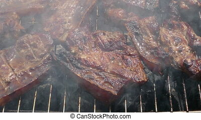 Pork Meat Steak on Barbecue Grill