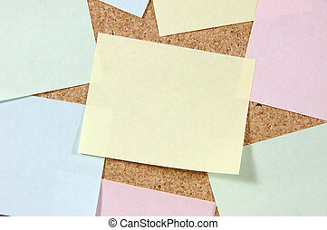 Close up of post-it notes on corkboard - Close up of...