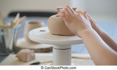Close-up of potter making pot in pottery workshop. Using ...