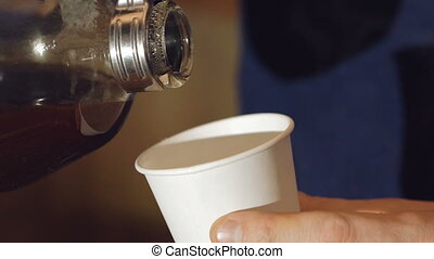 Close up of pouring coffee into cup. Slowly