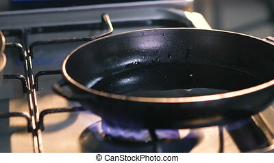 Close up of pouring frying pan with oil. Slowly