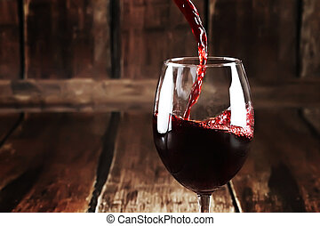 Close up of pouring wine in glass