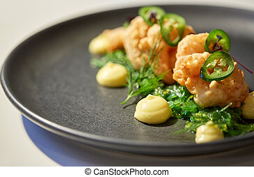 close up of prawn salad with jalapeno and wakame