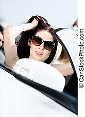 Close-up of pretty female driver