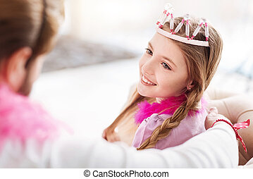 Close up of pretty girl wearing crown on the head