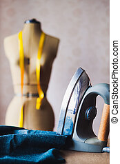 Close up of professional iron in a tailor's factory, tailoring theme