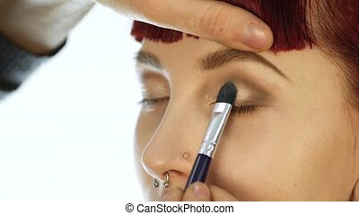 Close-up of professional make-up artist doing everyday...