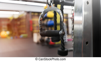 Close-up of pull rope handle in a gym