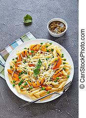 close-up of pumpkin and pasta salad
