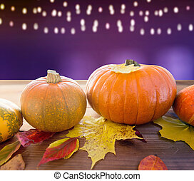 close up of pumpkins on wooden table