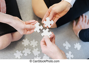Close up of puzzle pieces being put together