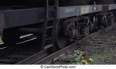 Close-up of railway tracks and train wheels