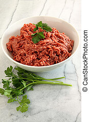 Close up of raw ground beef on cutting board
