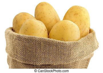 close up of raw potatoes in a jute bag