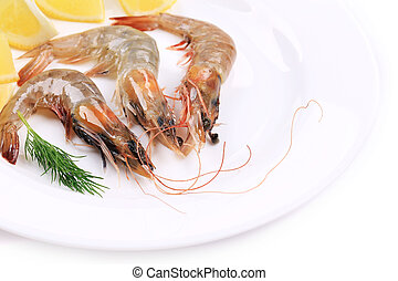 Close up of raw shrimps with lemon.
