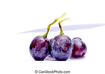 Close-up of red grape on white background