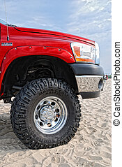 Close-up of red jeep in the dunes